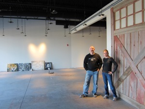 Kevin Kuster and Kerry Hoskins Branson stand in the Creator Gallery space being prepared for opening in late 2012