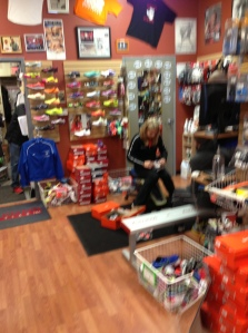 Caroline Cayton is in constant motion fitting customers in the St. Charles, Illinois Dick Pond Athletics store.