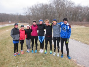 Athletes on the Multisport Madness Triathlon Team gather for a quick team photo between intervals.