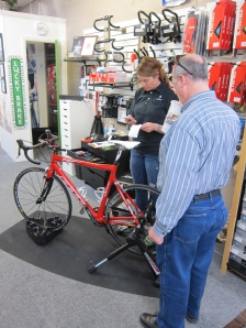 "Another curious customer stops by to ask about the bike fit process. His ""prescription"" cost $60 for a casual bike."