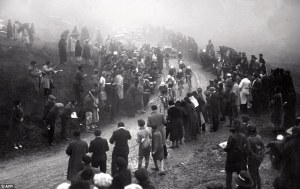 Zombie cyclists move through the murk and mud in an early version of the Tour de France.