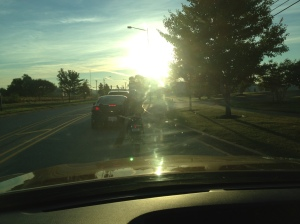 Click to enlarge photo. You can still hardly see details between the sun, a dirty windshield and early morning shadows.