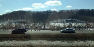 The hills seem to be watching traffic pass by on Interstate 94 near Eau Claire, Wisconsin.