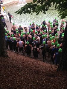 Swim competitors line up for their chance to hit the 68-degree water. It was warmer than the air.