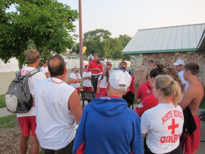 A crew of more than 30 Lifeguards receives pre-race instructions.