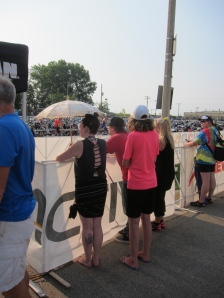 The scene at most triathlons includes plenty of colorful, stylish spectators and support crews.