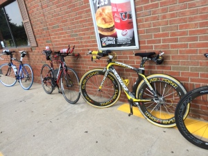 A group of tri-bikes awaits  the return of riders from a rest break at the halfway point.