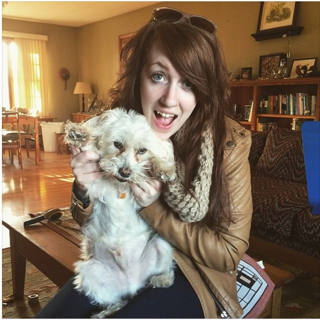 Emily Joan Cudworth with her super buddy wonder dog Chuck. Nice paws!
