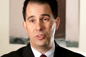 "Wisconsin Gov. Scott Walker talks during an interview with the Associated Press in New Orleans, Monday, May 18, 2015. Republicans clashed over the future of government surveillance programs on Monday, highlighting a deep divide among the GOP's 2016 presidential class over whether the National Security Agency should be collecting American citizens' phone records in the name of preventing terrorism. Walker three times declined to say whether he supported reauthorizing the program. He said it was ""important to be able to collect information like that,"" as long as there were unspecified privacy safeguards. After the interview, a spokesman emailed to say that Walker supported continuing the program as it exists, with the NSA storing American phone records. (AP Photo/Gerald Herbert)"