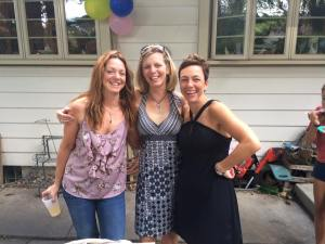 Sue (center) with her sister Julie Dunn (left) and Anne de Traglia. All are triathletes.