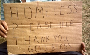"""homeless - please help"" sign"