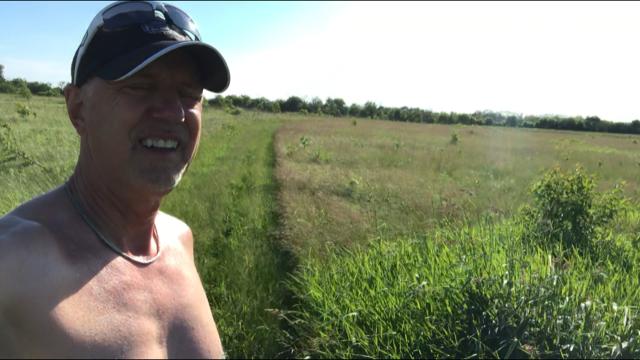 Chris in field.png